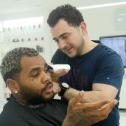 Kevin Gates being served by Celebrity Barber, Barber Mo from SKILLS Dubai Barbershop