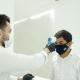 SKILLS Dubai Barbershop Barber Mo checking Barber Vince Temperature