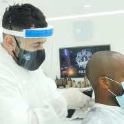 Barber Mo Wearing FULL PPE serving a client at SKILLS Dubai Barbershop