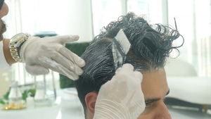 Applying the Hair Relaxer for the Hair Straightening Relaxing Treatment