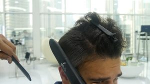 Ironing The Hair After Application of the Keratin Hair Treatment